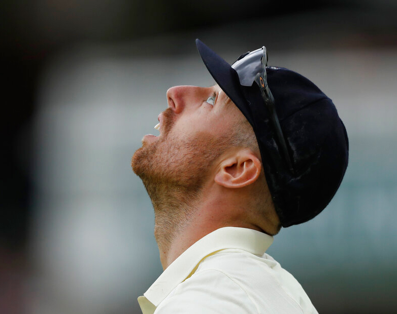 England's Jack Leach looks up at the clouds as he fields during play on day five of the 2nd Ashes Test cricket match between England and Australia at Lord's cricket ground in London, Sunday, August 18, 2019.