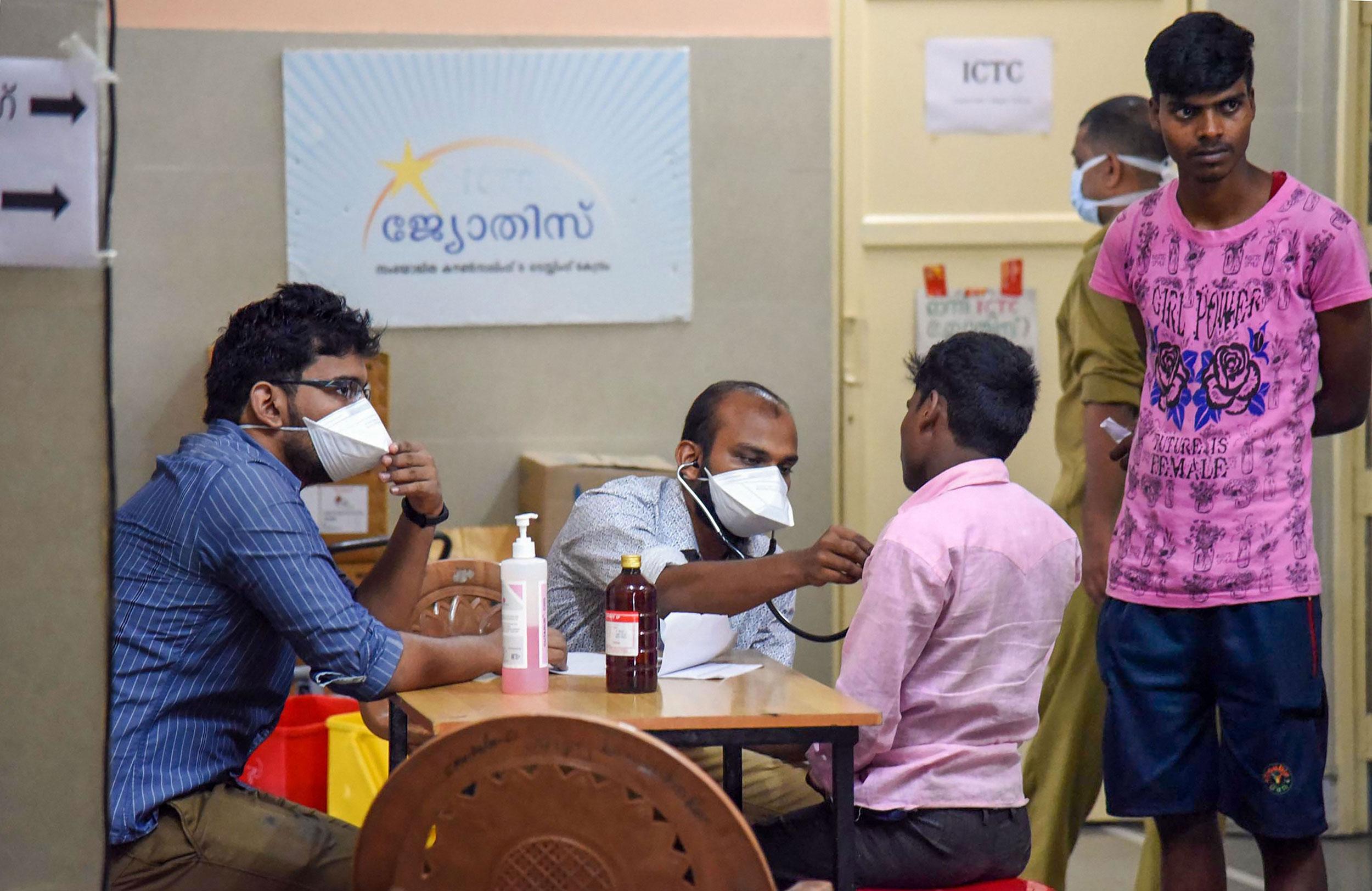 Doctors check patients for symptoms of Nipah virus at Ernakulam Medical College, Kochi, on June 5, 2019.