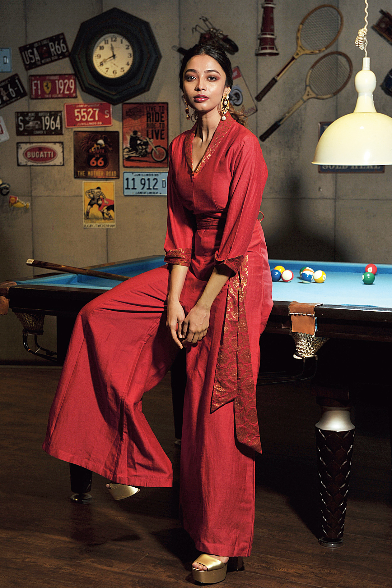 Rocking in red: Diwali night will most probably see you hitting a party pad to wrap up the revelry. Your outfit could easily be this red muga silk jumpsuit with brocade detailing on the belt, collar and sleeves. A trendy yet elegant look with a touch of tradition