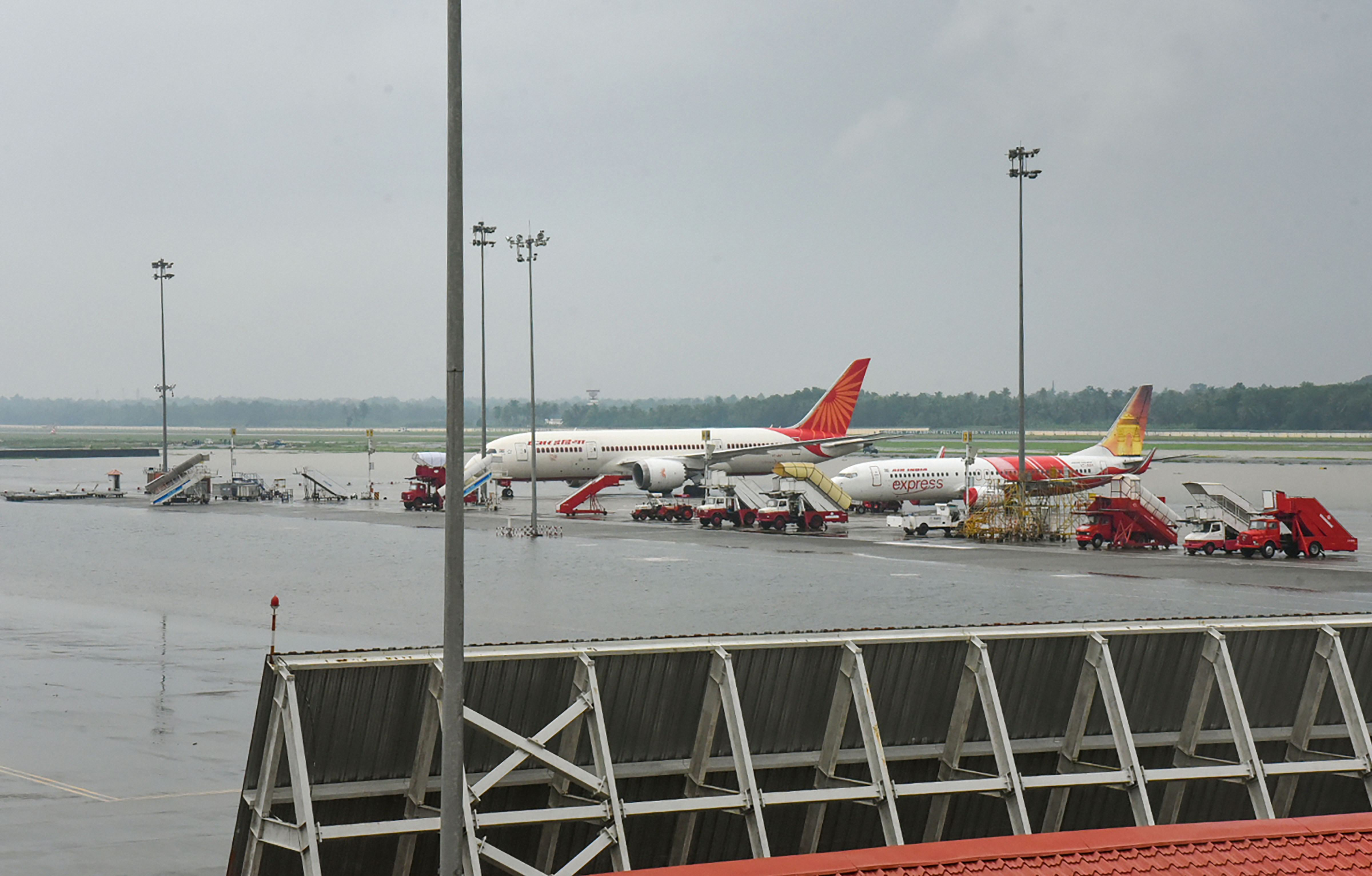 Planes stand parked at Kochi airport as all operations were suspended following waterlogging on the runway on August 9.