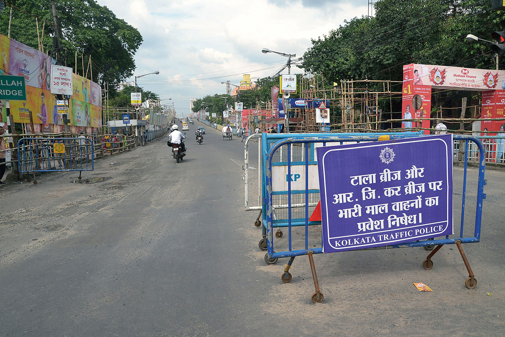 A signboard near the Tallah bridge reads heavy vehicles are not allowed