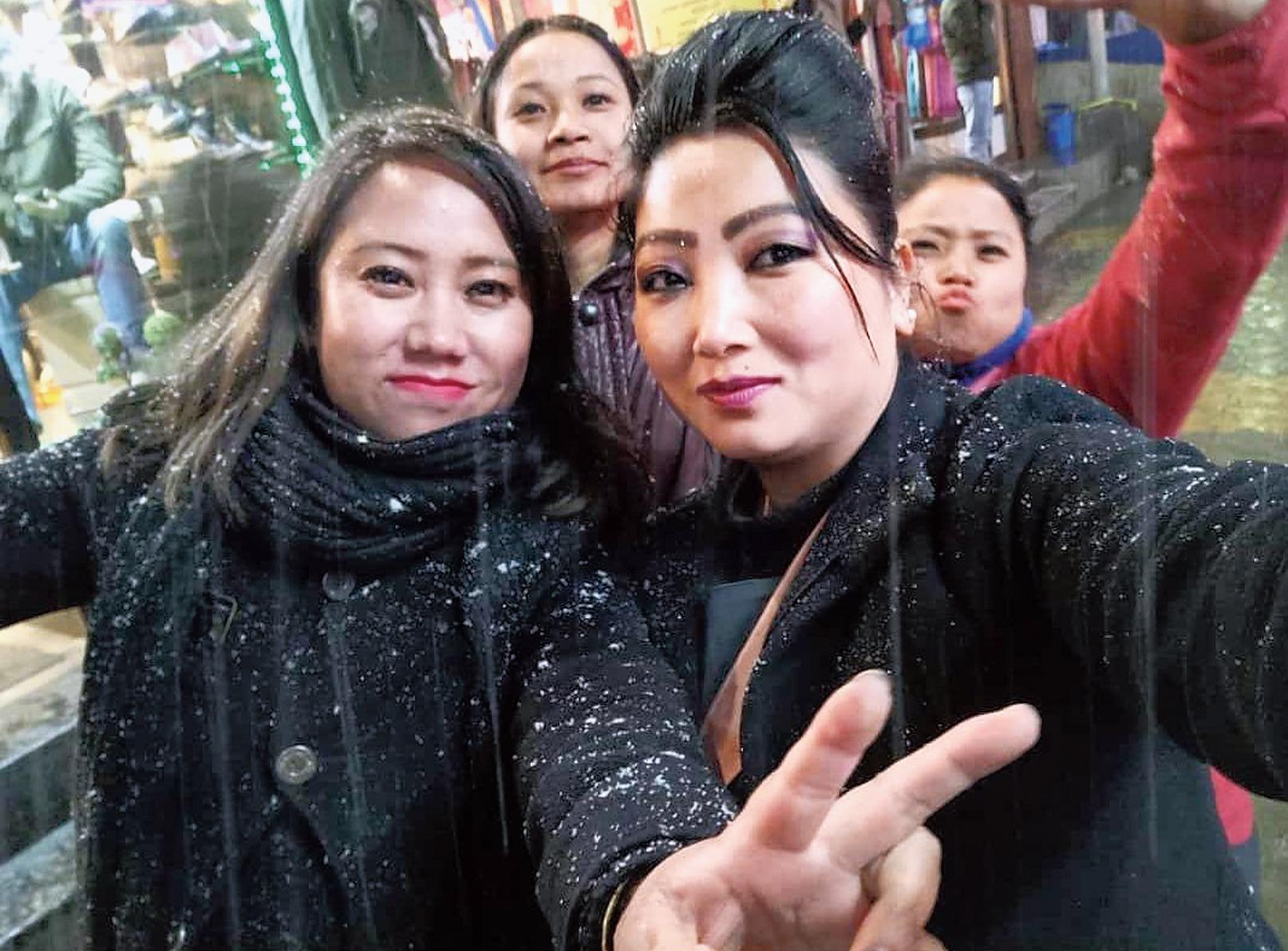 Girls click a selfie during the snowfall in Darjeeling.