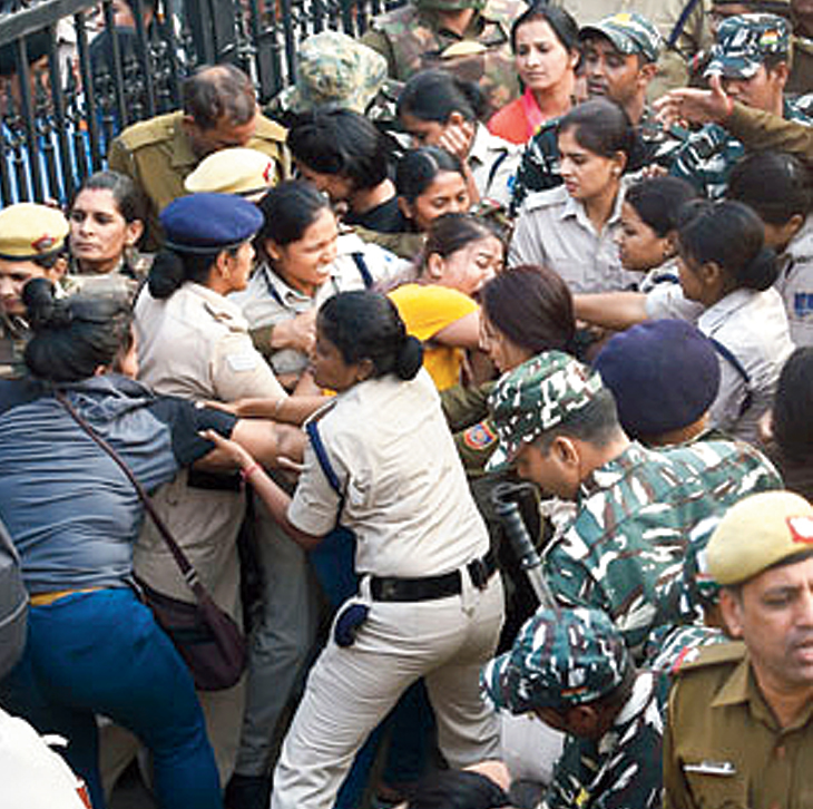Jawaharlal Nehru University students clash with police during a protest against the administration's 'anti-students' policy, in New Delhi, Monday, November 11, 2019