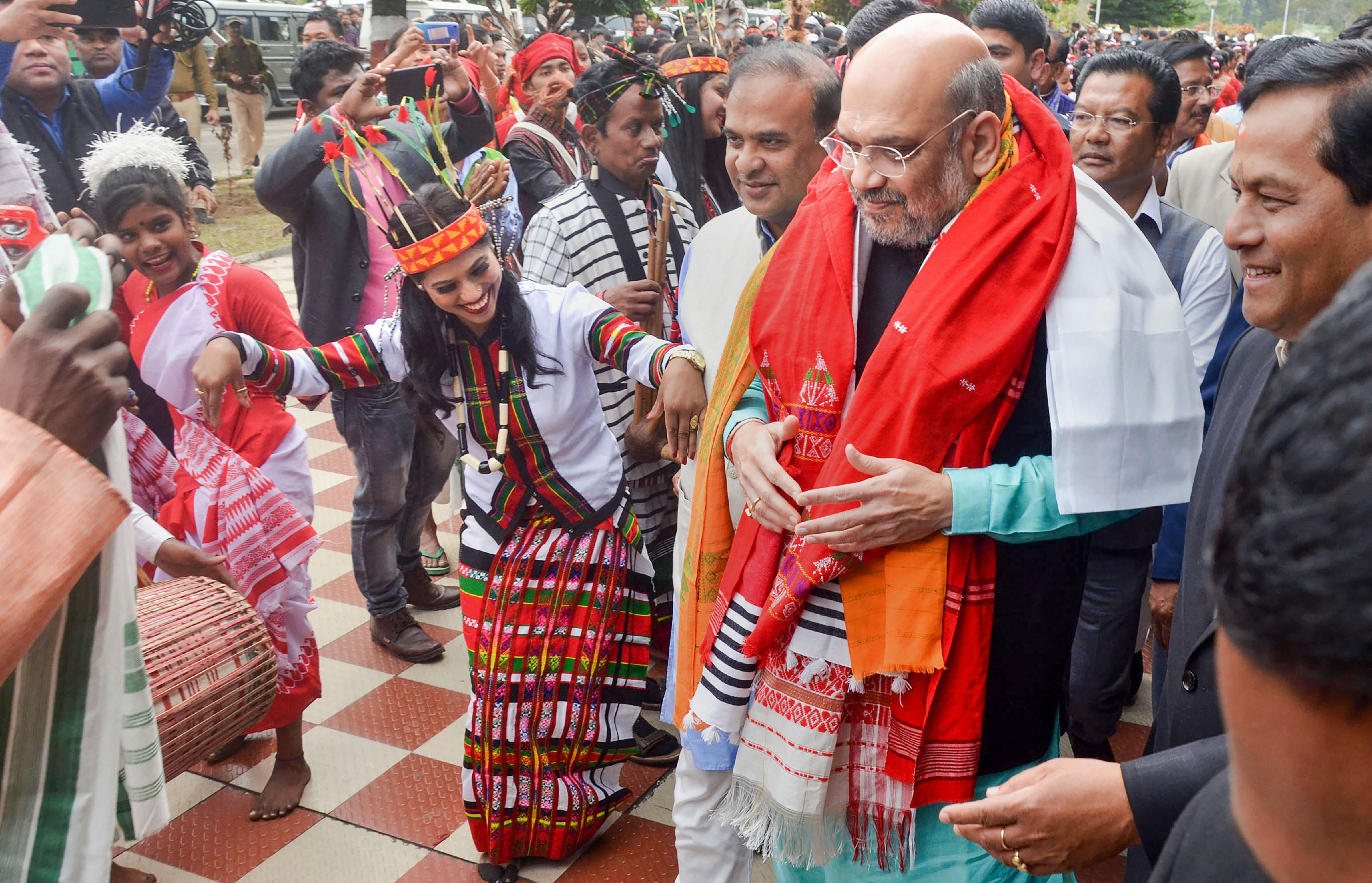 Artistes perform as Union home minister Amit Shah arrives to attend the 34th statehood day of Arunachal Pradesh, in Lakhimpur Kheri district, Thursday, February 20, 2020