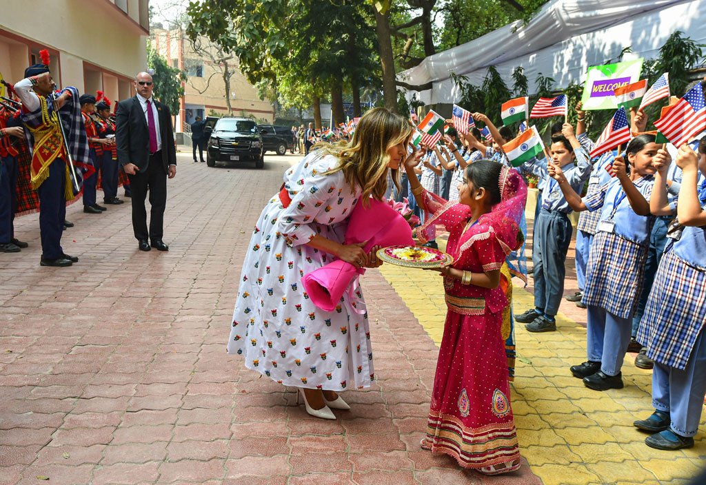US First Lady Melania Trump being welcomed during her visit to a government school to witness various activities as part of the happiness curriculum, in New Delhi, Tuesday