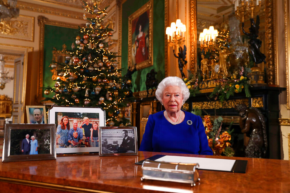 Queen Elizabeth II on December 24 poses for a photo while recording her annual Christmas Day message to the nation at Windsor Castle