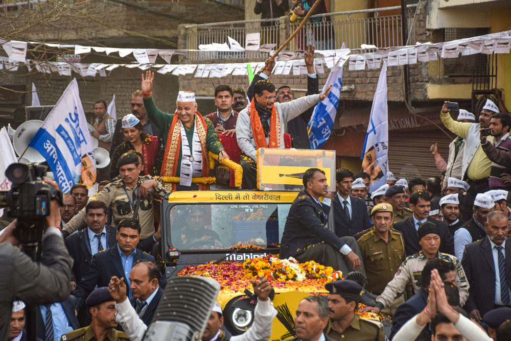 Delhi Chief Minister Arvind Kejriwal during an election campaign roadshow ahead of the State Assembly elections, at Patparganj in New Delhi, on Monday