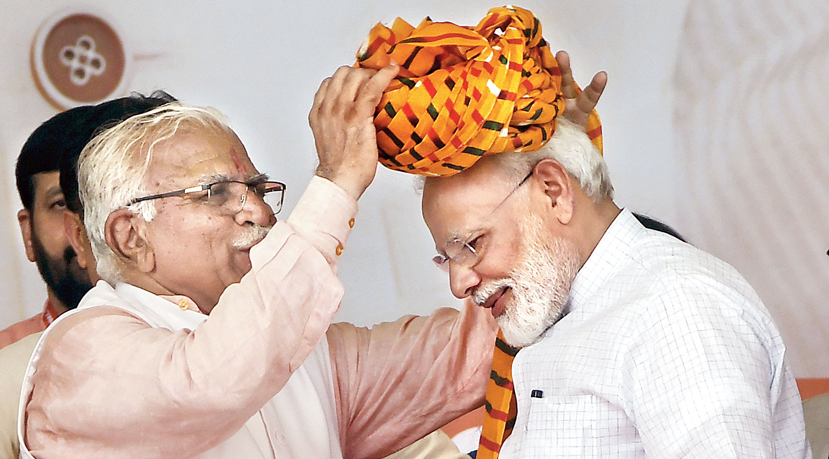 Haryana chief minister Manohar Lal Khattar presents a turban to Prime Minister Narendra Modi in Rohtak. The Congress also recalled that Khattar had publicly said after the revocation of Kashmir's special status that women from there could now be brought for marriage.
