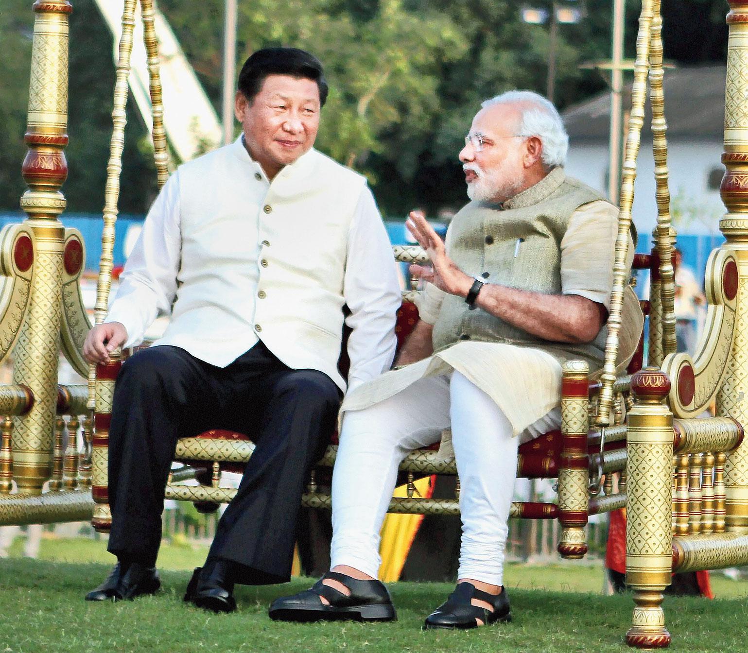 Xi with Modi in Ahmedabad in 2014.