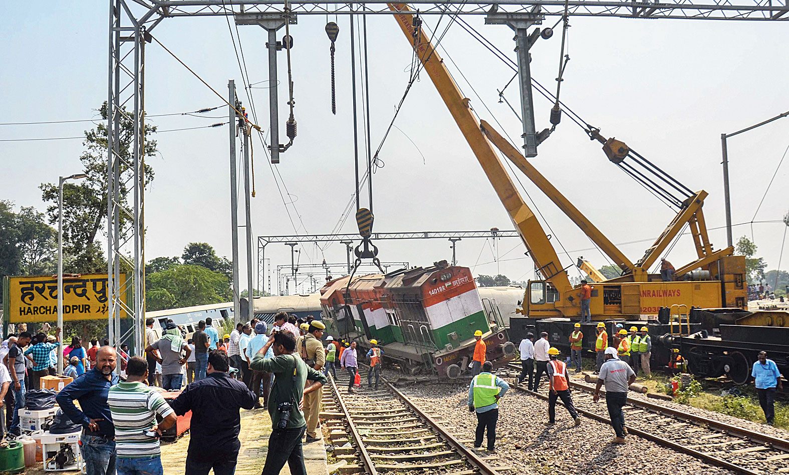 Cranes remove the derailed engine and coaches of the New Farakka Express near Rae Bareli on Wednesday.