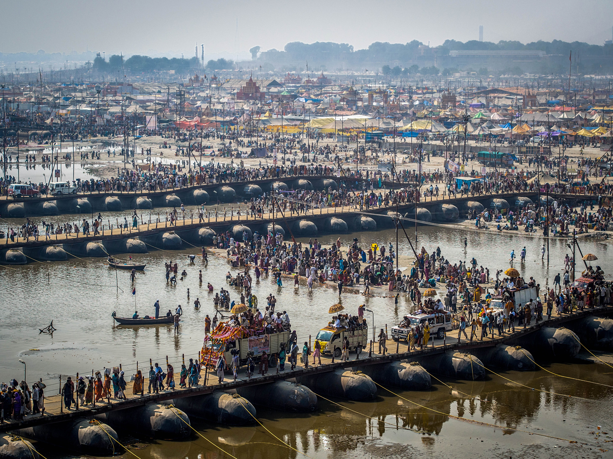 Thousands of Hindu devotees crossing the pontoon bridges over the Ganges River at Kumbh Mela festival in Allahabad, India, the world's largest religious gathering.