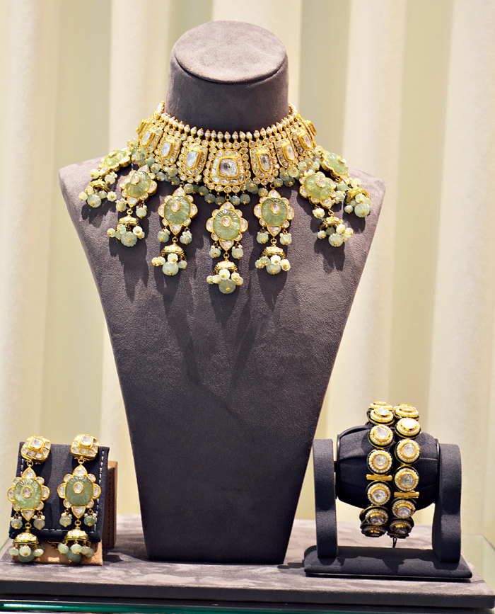 Pair this pastel-hued 18-carat gold bridal set studded with polkis, pearls and Russian emerald, with a contrast-coloured lehnga for a glam-chic look.  Rs 25,00,000 @ Nemichand Bamalwa and Sons (J)