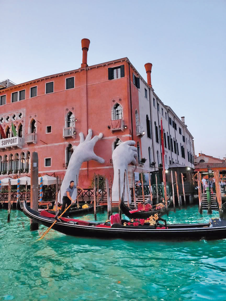 Artist Lorenzo Quinn's installation of a monumental sculpture for the 2017 Venice Biennale