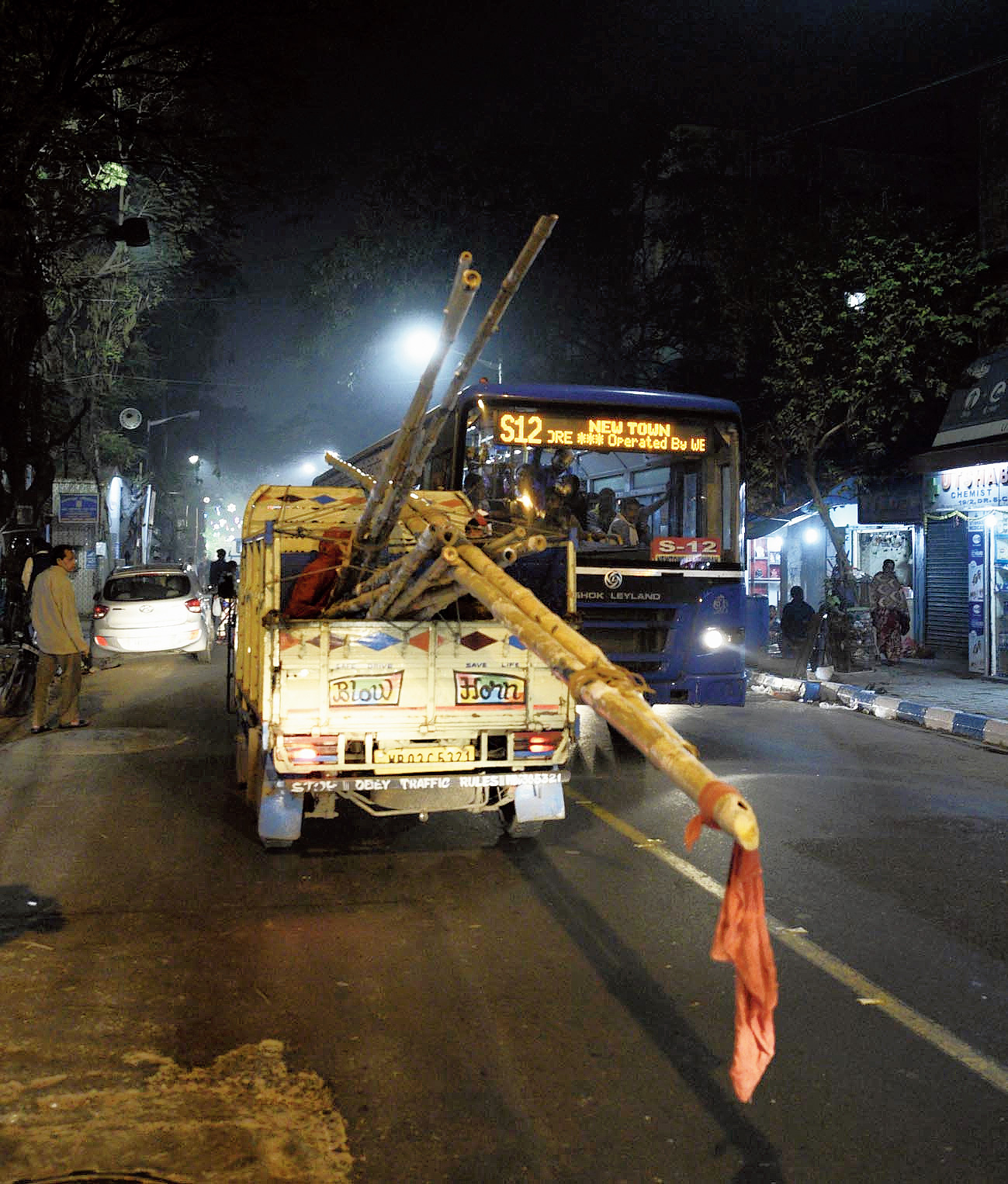 Bamboo poles stick out of a mini truck on Beleghata Main Road on Friday night.