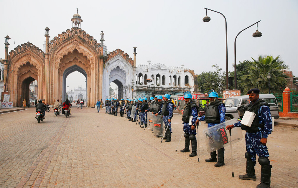 Security personnel stand guard on a street after violence erupted Thursday during a protest against the Citizenship Amendment Act in Lucknow, Friday, December 20, 2019.