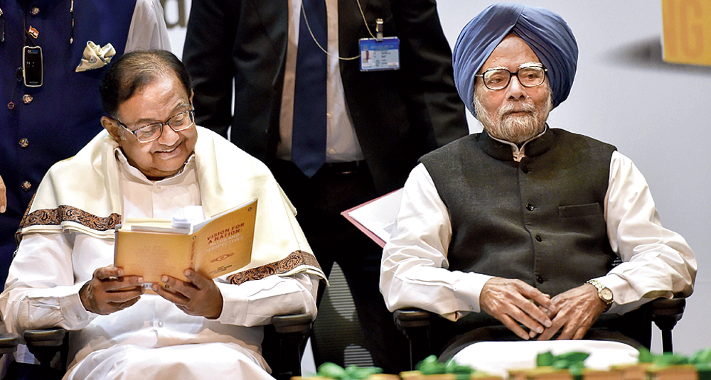 P Chidambaram (left) and Manmohan Singh at the book release on Wednesday
