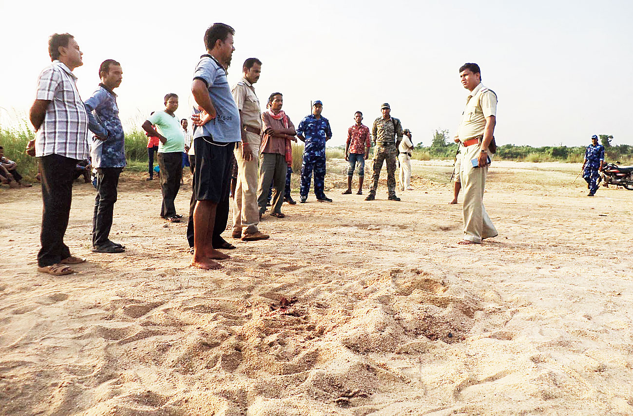 The police inspect the spot at Khoirasol where Dipak Ghosh was attacked.