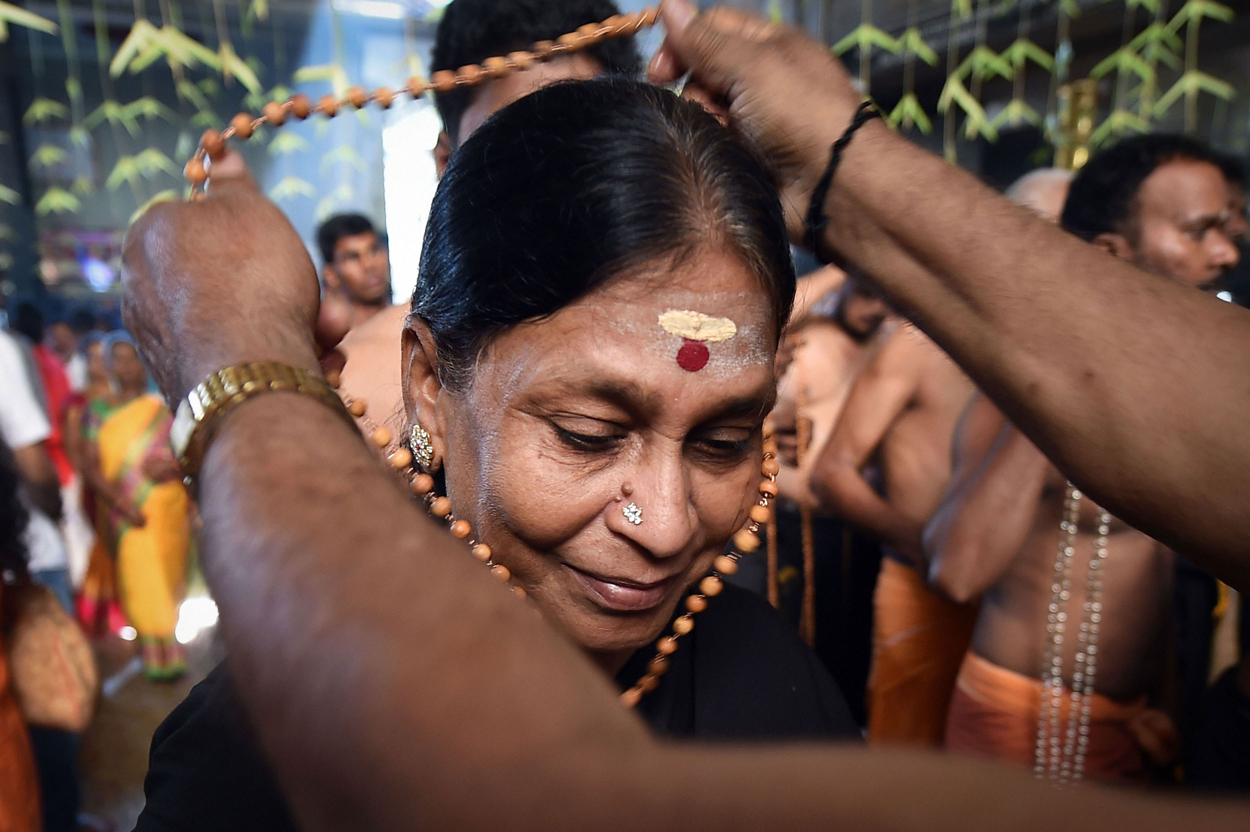 A devotee at a temple before their pilgrimage to Lord Ayyappa temple in Sabarimala in Chennai on November 17, 2019.