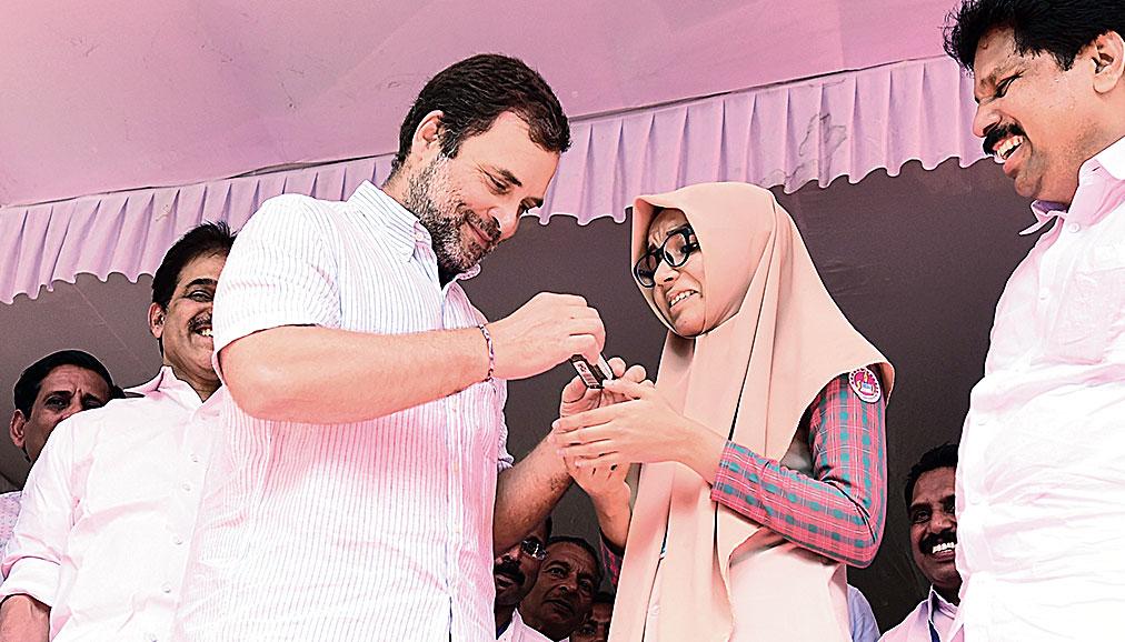 Rahul Gandhi with Safa Febin at the school in Malappuram, Kerala, on Thursday