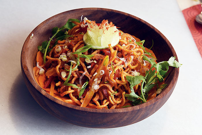 The tangy Tangra-style Chinese Bhel has spices sauteed with stir-fried noodles and makes for a quick, fuss-free snack.  Rs 195