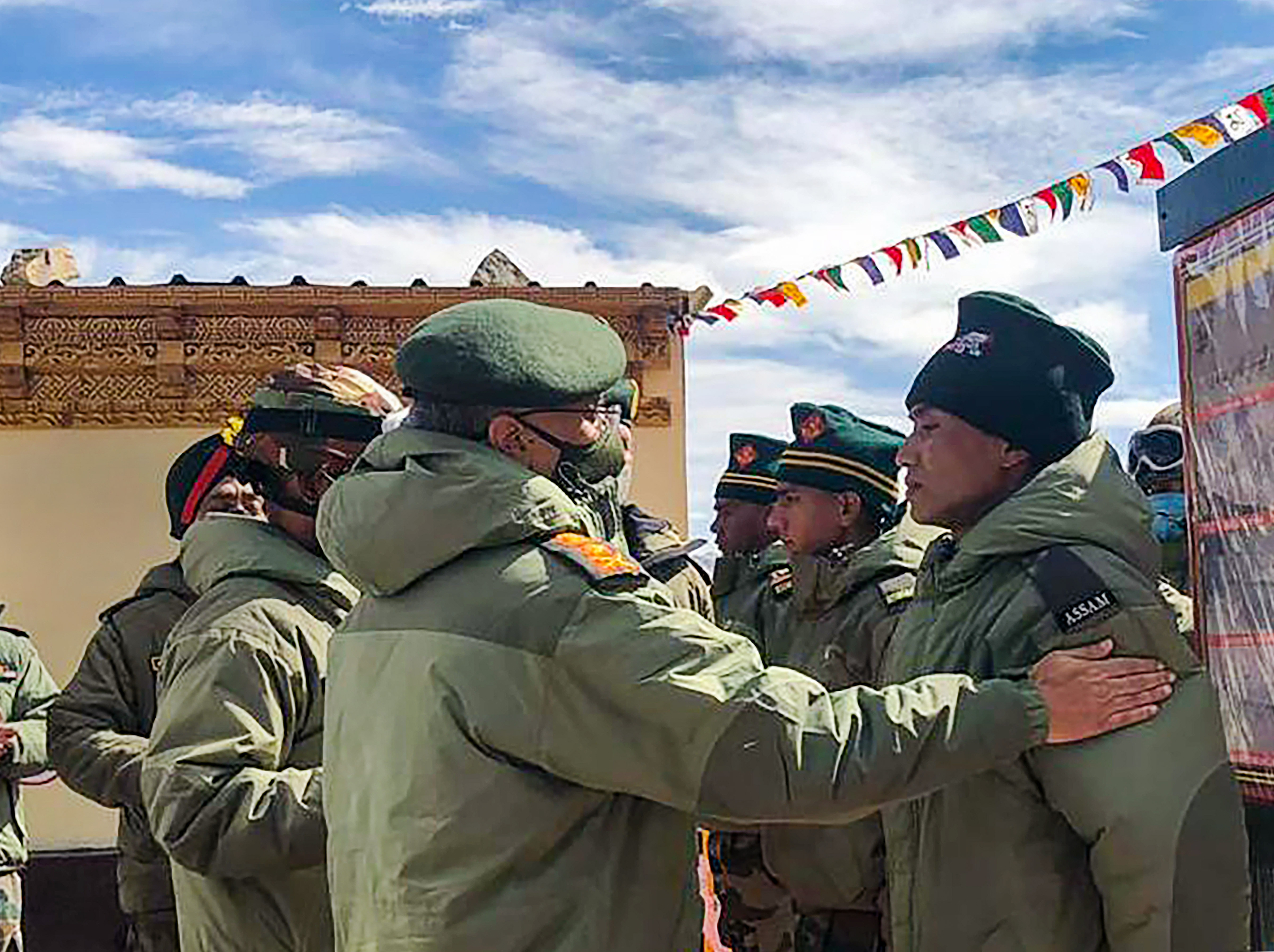 Army Chief Manoj Mukund Naravane interacts with troops while reviewing operational situations on the ground after the stand-off in the region during his visit in Eastern Ladakh on Wednesday.
