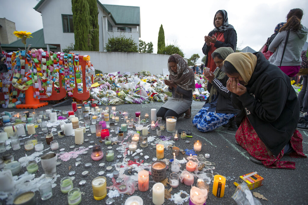 People mourn at a makeshift memorial site near the Al Noor mosque in Christchurch on Tuesday.