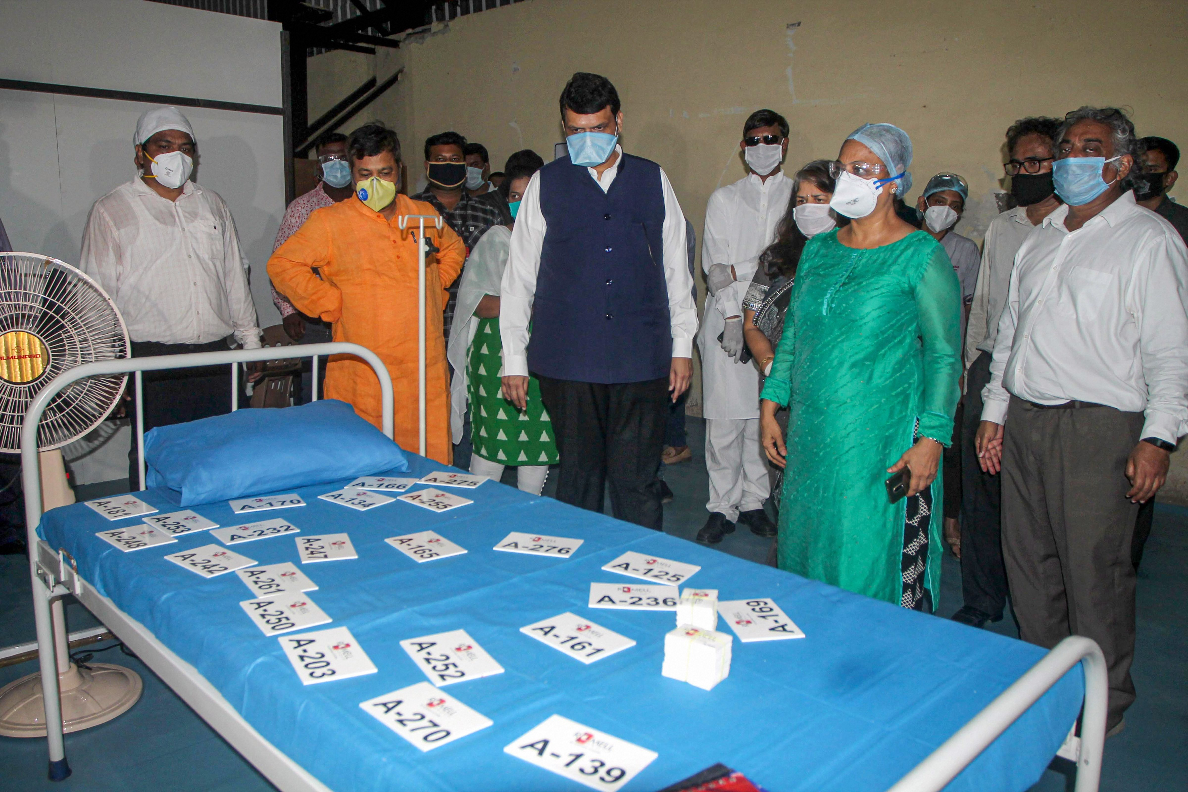 BJP leader Devendra Fadnavis visits a quarantine center for Covid-19 patients at Bombay Exhibition Centre, during the nationwide lockdown in wake of the coronavirus pandemic, at Goregaon in Mumbai, Monday, June 1, 2020
