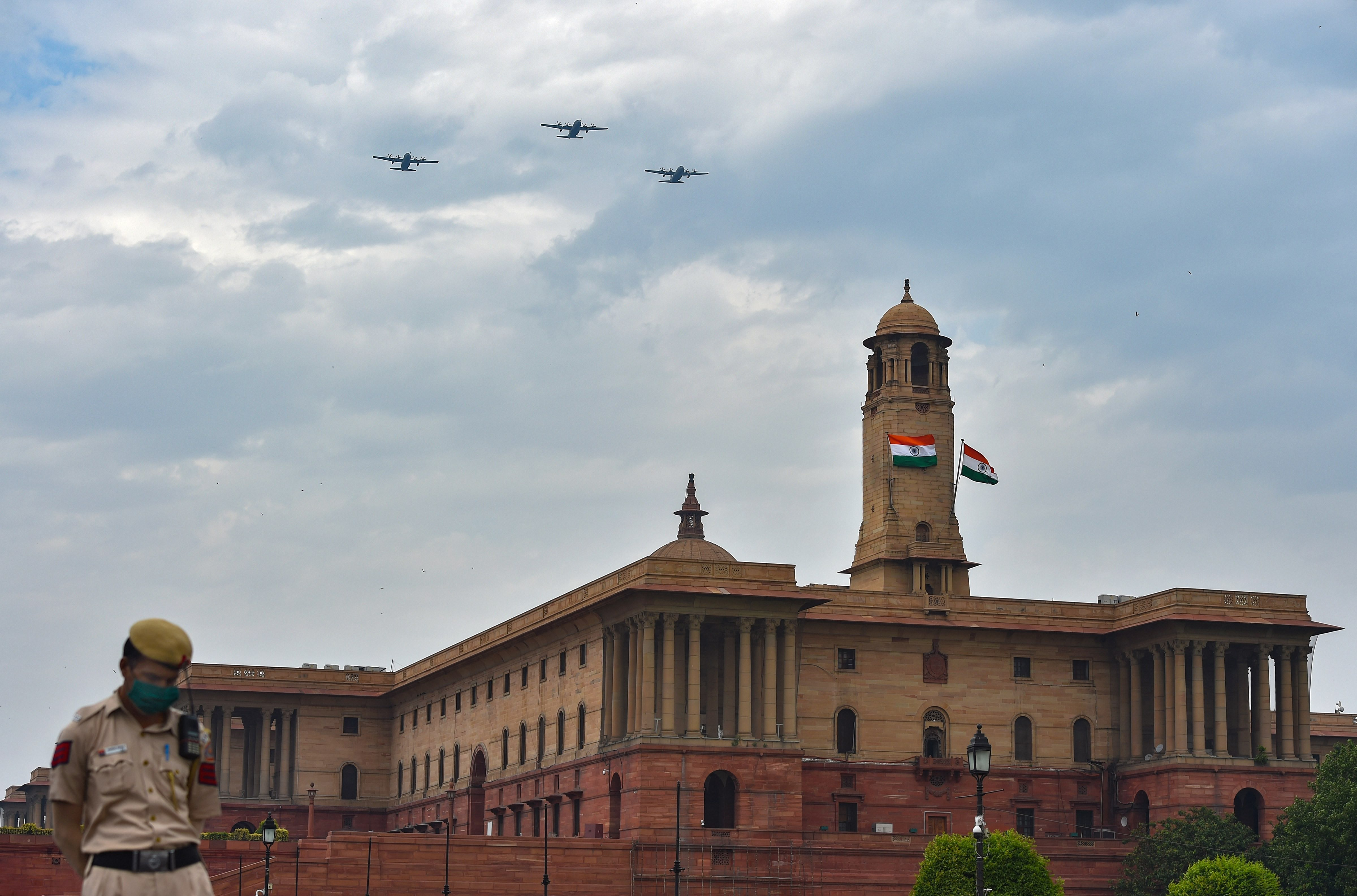 Three C-130 transport aircraft of the Indian Air Force fly over the Raisina Hill to express gratitude towards all frontline workers, including medical professionals, police and sanitation workers for their contribution in fight against Covid-19, in New Delhi, Sunday, May 3, 2020.