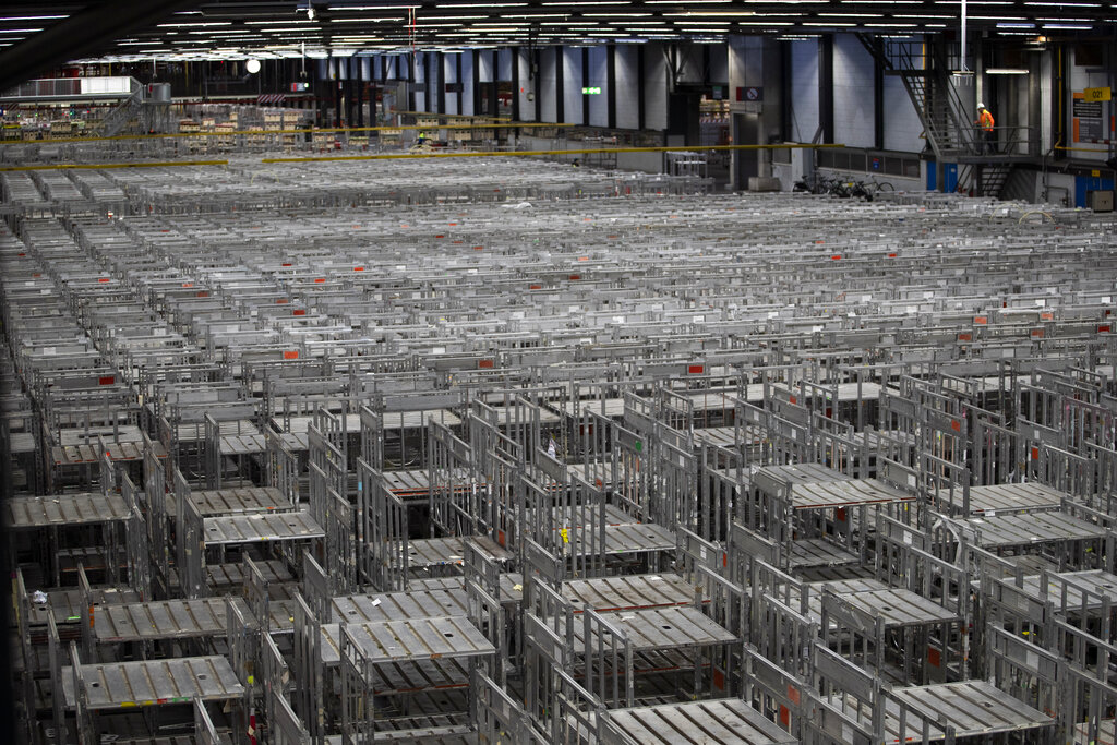 Empty racks are seen at flower auctioneer Royal FloraHolland in Aalsmeer, Netherlands, Thursday, March 19, 2020. Sales at major Dutch growers have slumped, forcing farmers to destroy their flower crops in this busy spring season when bulb fields erupt into color. With lockdowns and border restrictions around the world because of the coronavirus the Netherlands' multibillion dollar flower industry has slumped.