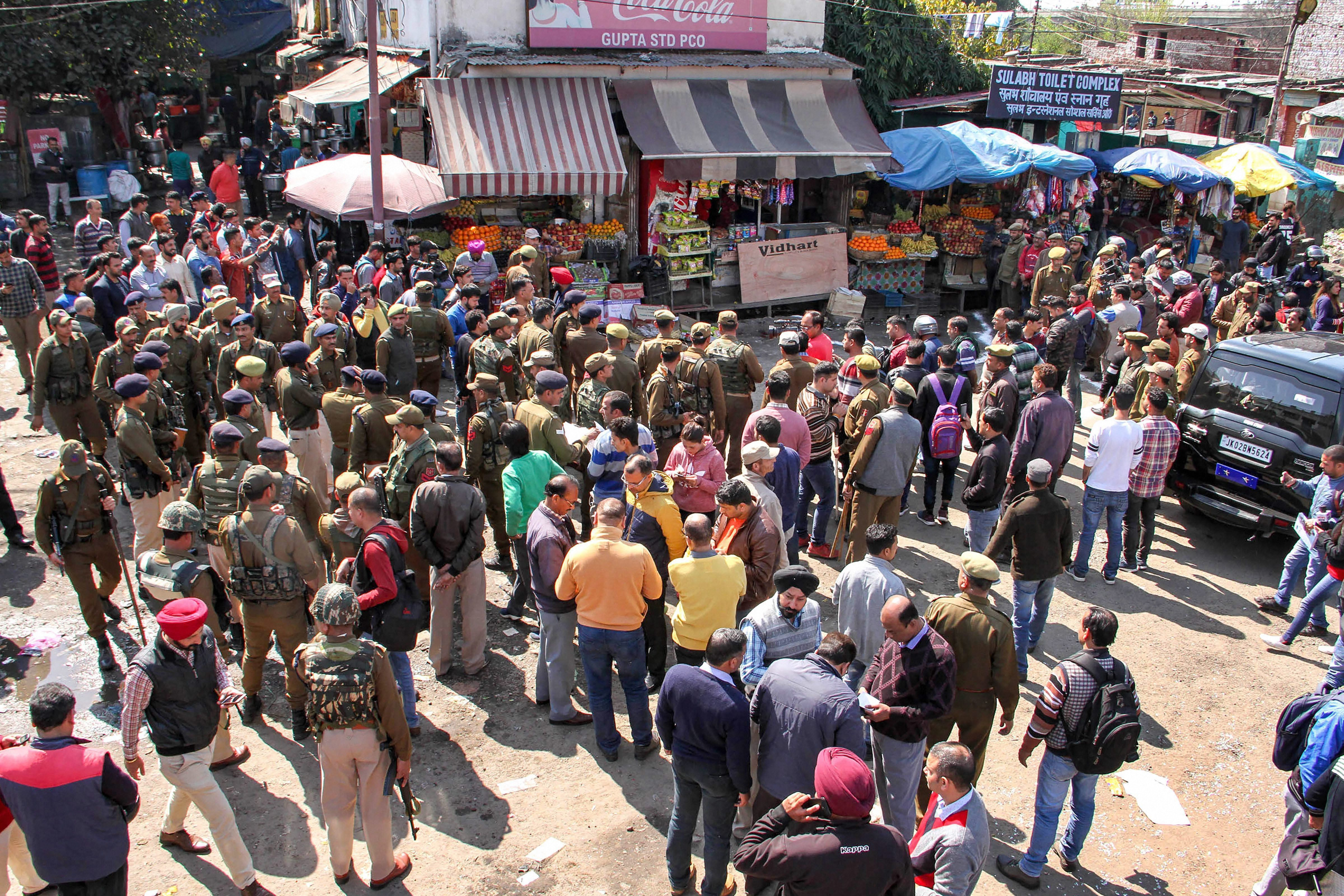 Police personnel inspect the site of the blast in Jammu on Thursday.