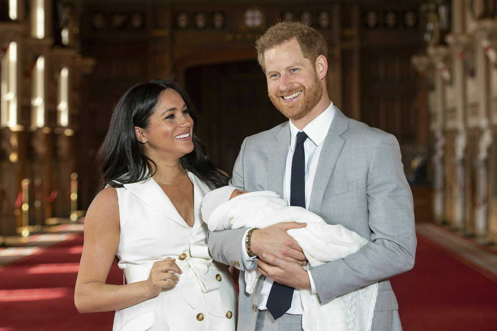 Britain's Prince Harry and Meghan, Duchess of Sussex, during a photocall with their newborn son, in St George's Hall at Windsor Castle, Windsor, south England, on Wednesday, May 8, 2019.