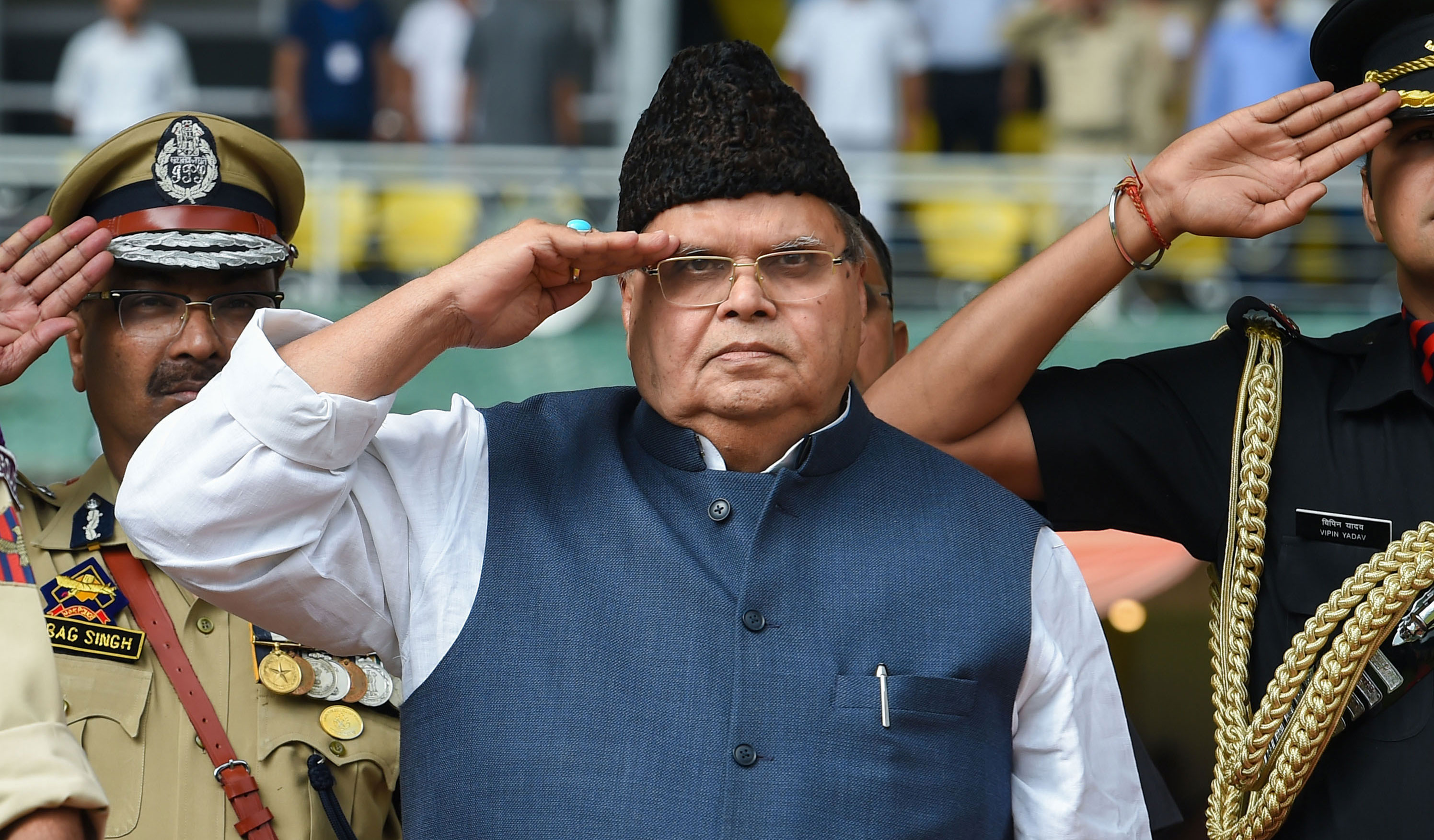 "Satya Pal Malik during the hoisting of the national flag at Sher-e-Kashmir Cricket Stadium in Srinagar on August 15, 2019. ""Our attitude is such  that there should be no loss of human lives. If there's no telephone for 10 days, so be it. But we will roll back these measures very soon,"" he said."