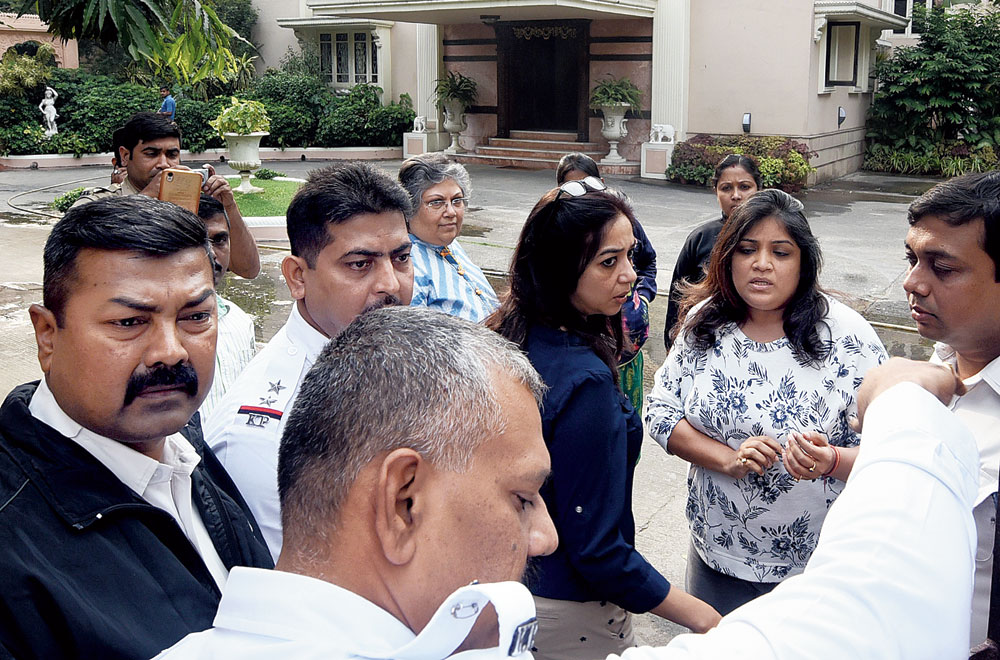 Nitya (second from right) and her mother (in striped kurta at the back) outside the Alipore bungalow of the Bangur family on Tuesday.