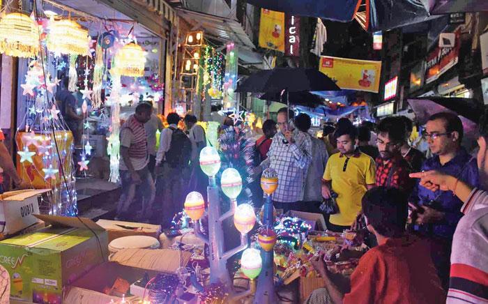 Diwali shopping under the brolly at Ezra Street