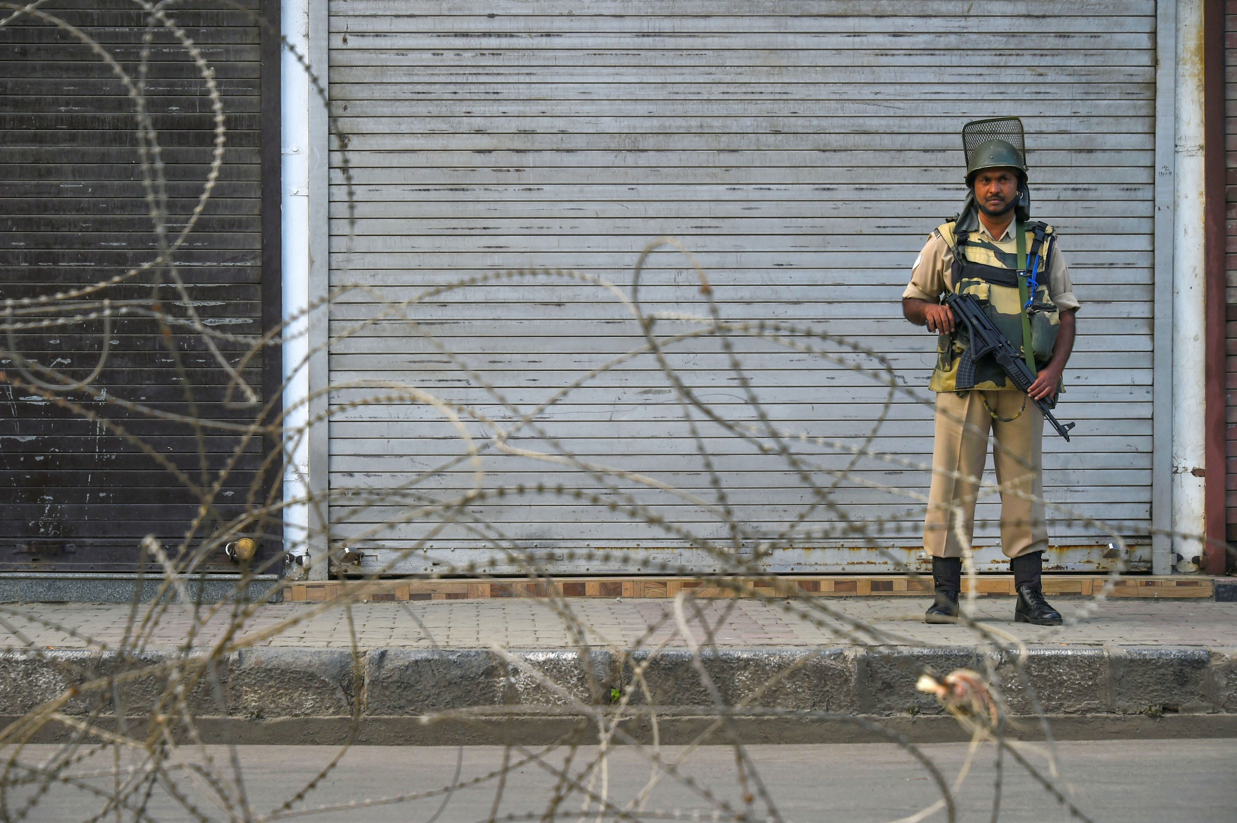 A security personnel stands guard during a shutdown, in Srinagar, Sunday, September 29, 2019