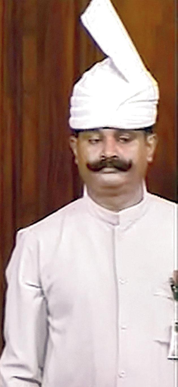 A Rajya Sabha marshal in the old uniform.