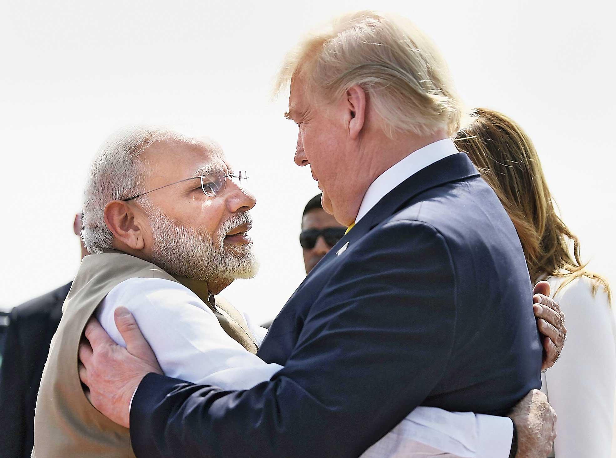 Narendra Modi greets Donald Trump at the Ahmedabad airport.
