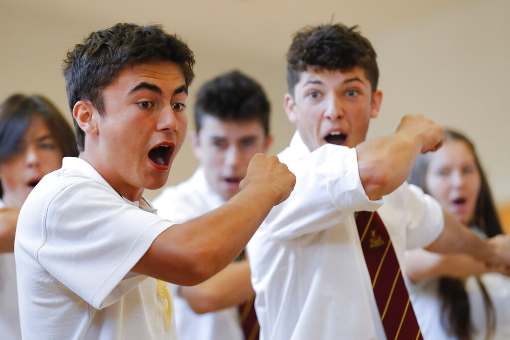 Students perform the Haka during the New Zealand Prime Minister Jacinda Ardern's visit to a high school in Christchurch.