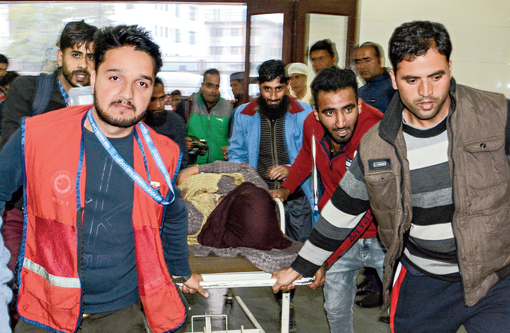 An injured civilian being shifted to the SHMS Hospital in Srinagar following a grenade blast in Sopore district on Monday.