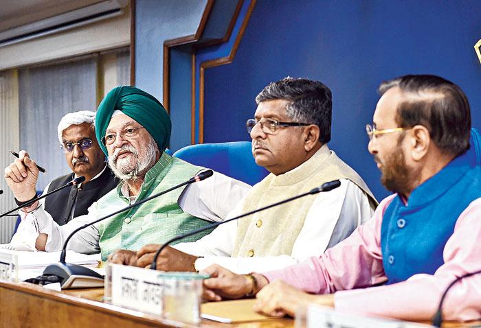 (From left) Union ministers Hardeep Singh Puri, Ravi Shankar Prasad and Prakash Javadekar announcing cabinet decisions in New Delhi on Wednesday