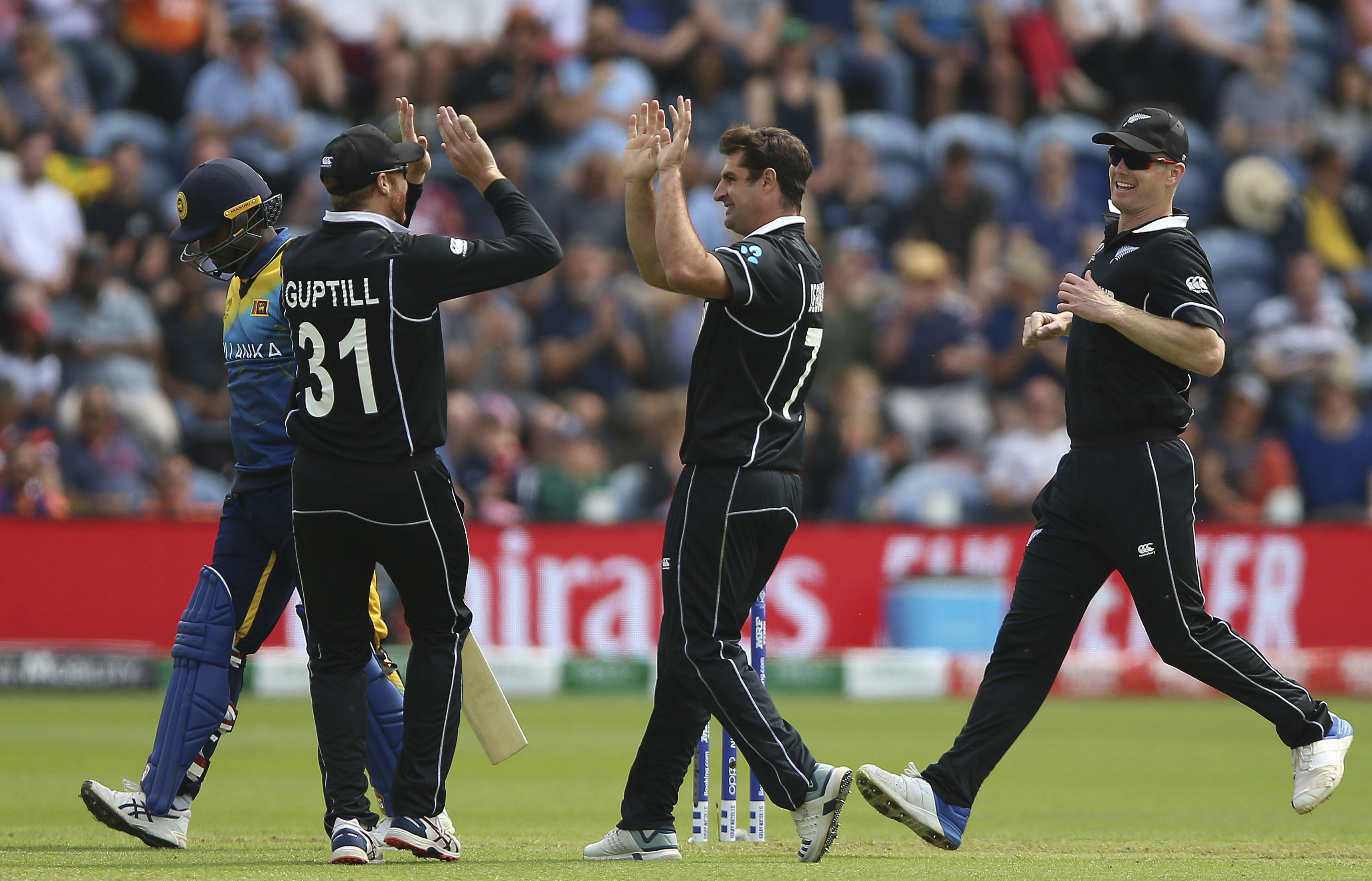 New Zealand's Colin de Grandhomme (centre) celebrates after taking the wicket of Sri Lanka's Angelo Mathews (left) in Cardiff, Wales, on June 1.