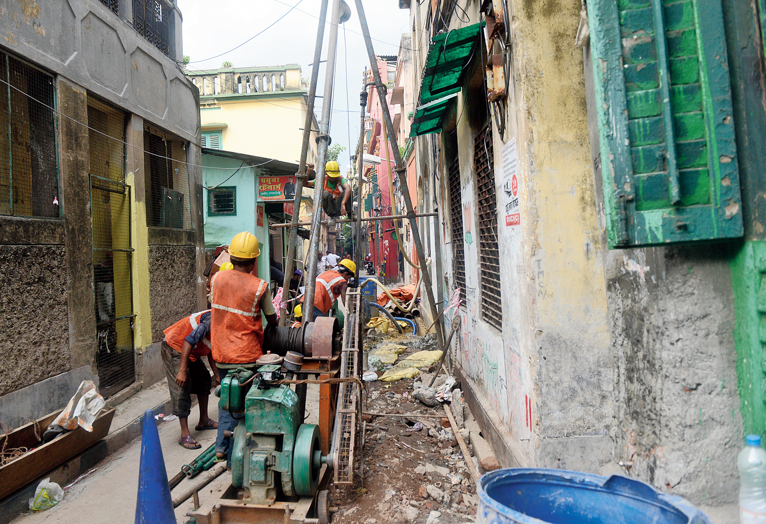 Men at work in Bowbazar on Monday.