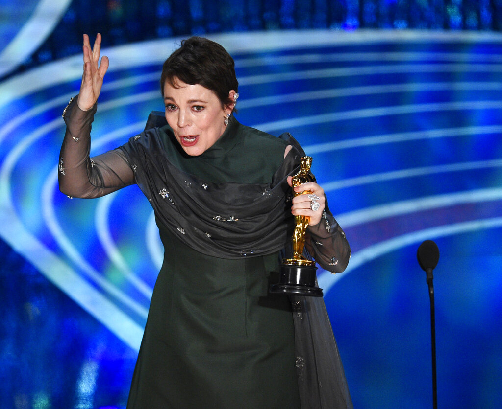 Olivia Colman reacts as she accepts the Best Actress Oscar for The Favourite.