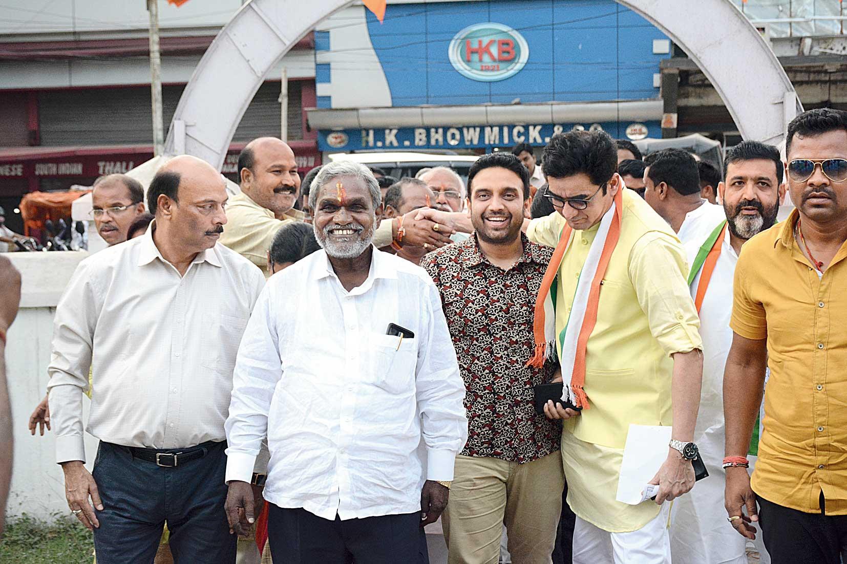 JMM's Champai Soren (in white shirt) with state Congress president Ajoy Kumar in Bistupur, Jamshedpur, on Thursday.