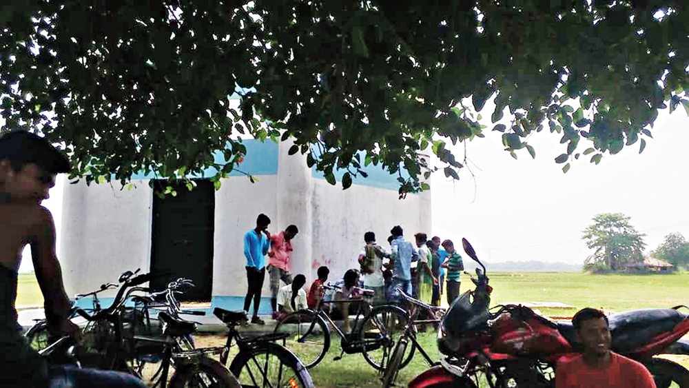 Villagers gather to receive payments from Mukherjee