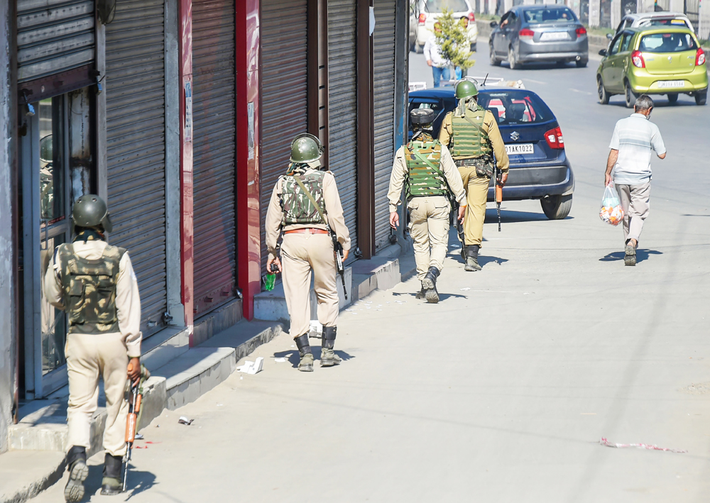 CRPF personnel patrol a street as situation in Kashmir continues to be tense and uncertain, in Srinagar, Sunday, August 4, 2019.