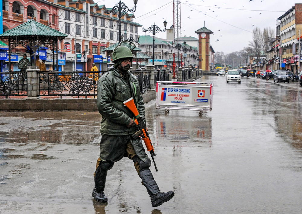 A security personnel stands guard at Lal Chowk during a strike call given by separatist leaders to protest against the alleged custodial death of a youth, in Srinagar on Wednesday, March 20, 2019.