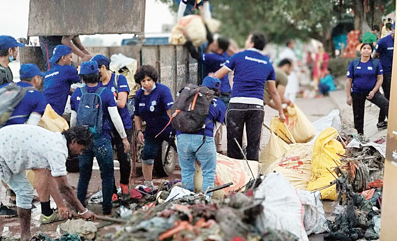 Mission Clean Gange team members carry out a cleanliness drive in Bijnor, UP, on Wednesday.