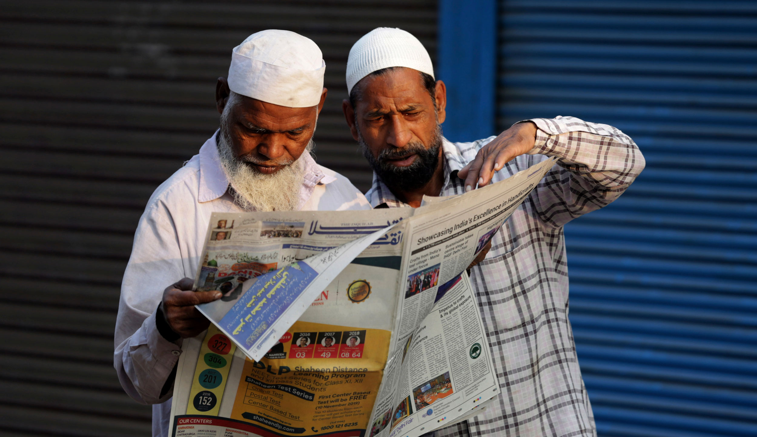 People read about the Supreme Court's verdict on the Ayodhya dispute in a newspaper in Ayodhya on Sunday, November 10, 2019.