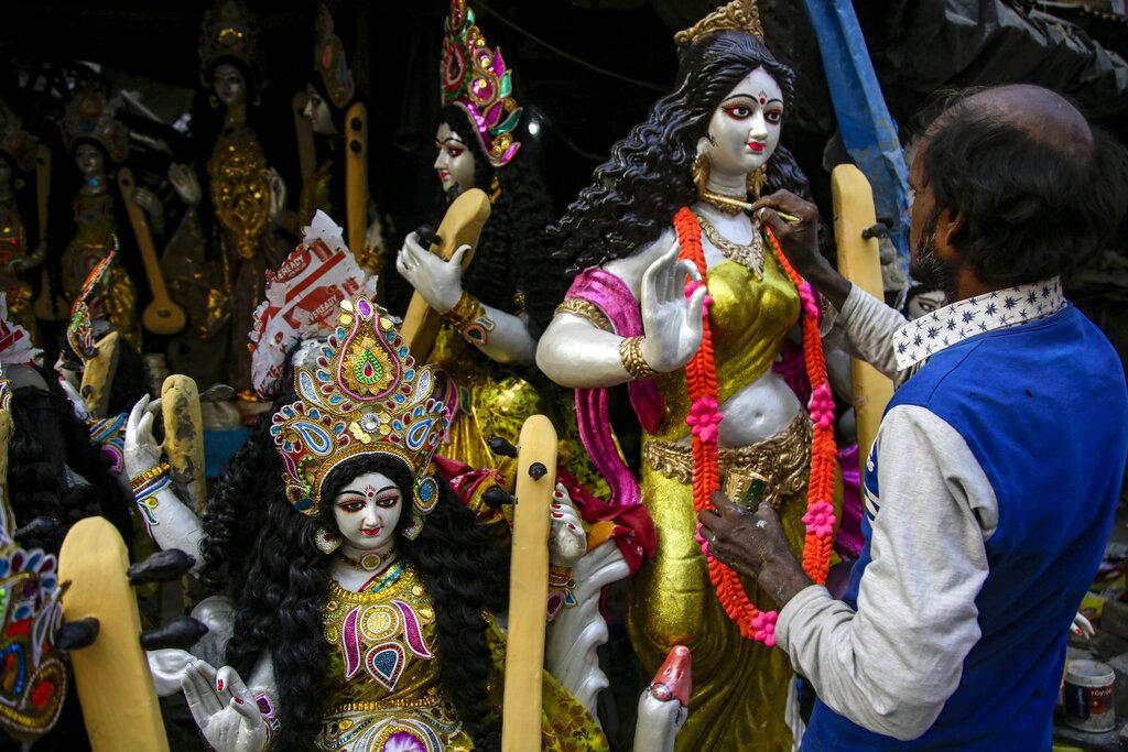 An artist gives finishing touch to a clay image of Saraswati, the Hindu goddess of wisdom, at his studio ahead of Basant Panchami in Kolkata